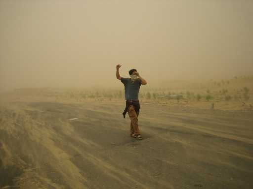 Hitchhiking during sand storm in Takla Makan